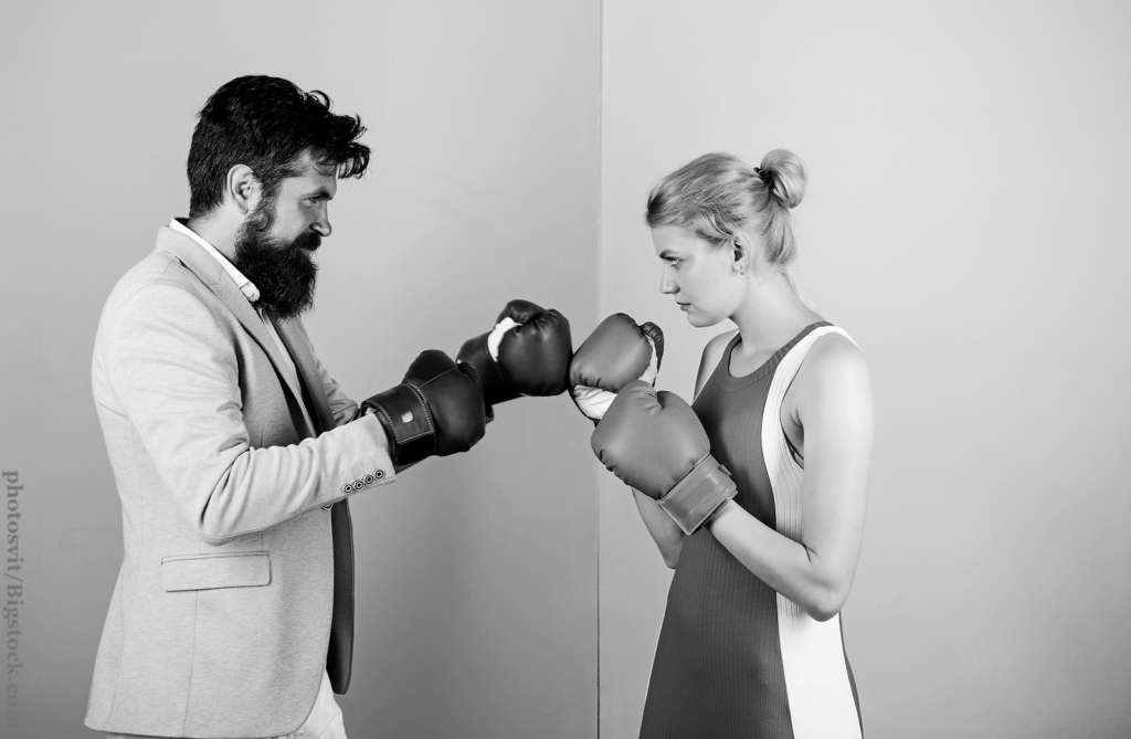 Man and woman boxing fight. Couple romantic relationships. Difficult relationships. Couple in love competing boxing.