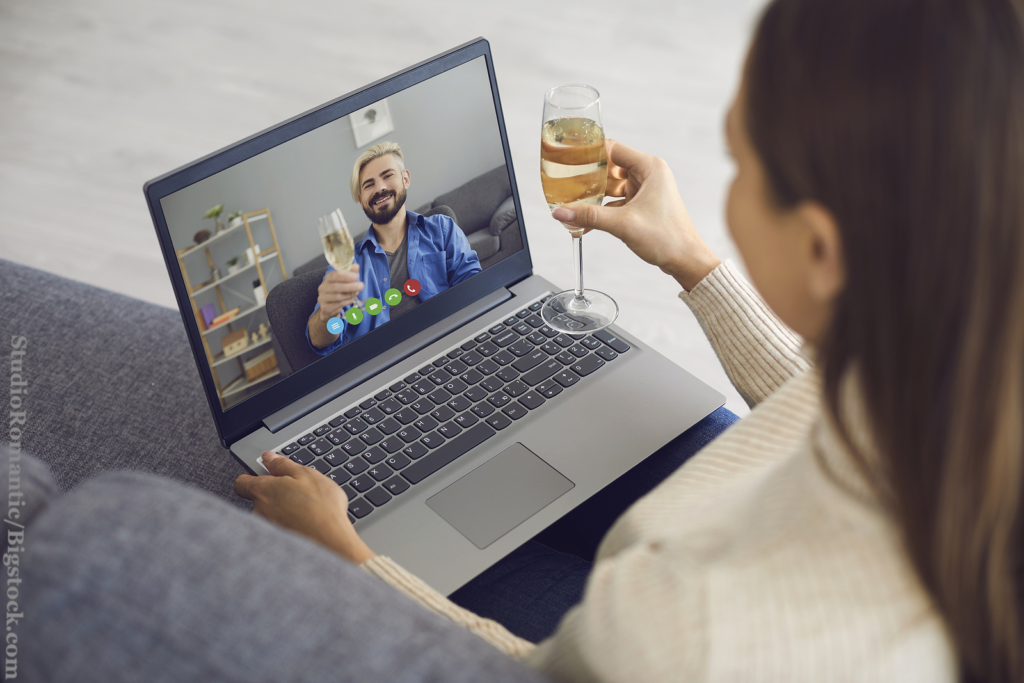 The 3-month rule limits opportunities. Date online. Man and woman with glasses of wine on a date using laptop video chat sitting at home.